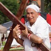 Mr. Joe as Simon of Cyrene bearing up Yeshua's Cross